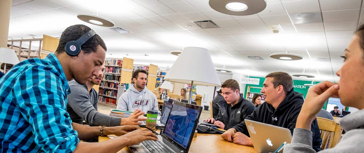 SIU Students working together at Morris Library