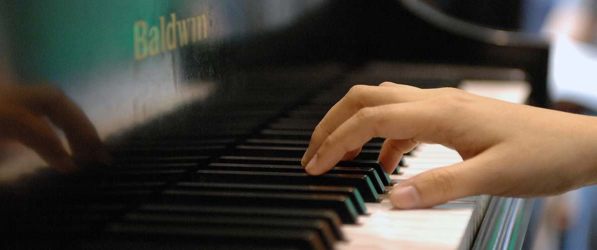 Closeup of student playing piano